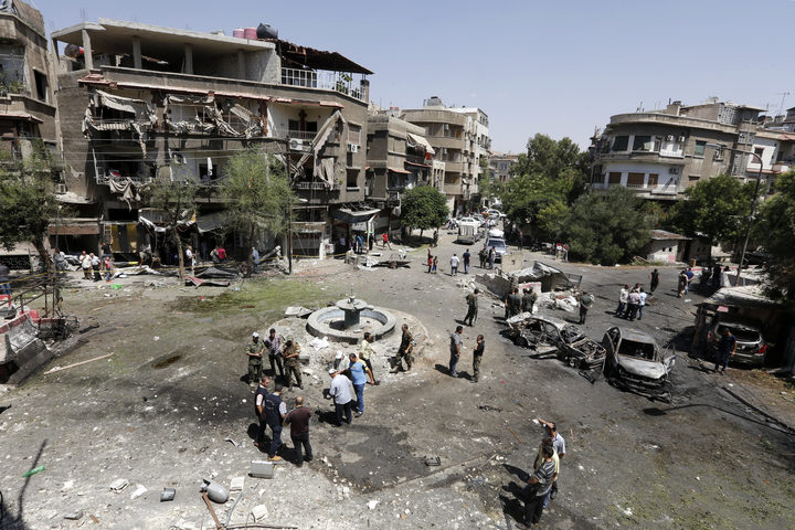 Casualties reported as vehicle bombs rock Damascus