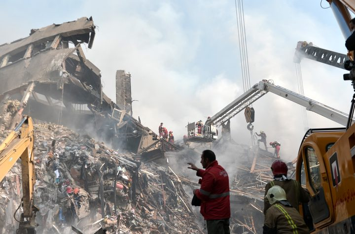 Search and rescue teams at the site of the Plasco Tower, in Tehran a day after the building caught fire and collapsed, killingat least 20 firefighters.