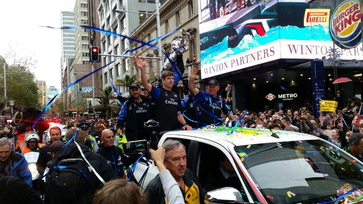 Tens of thousands of America's Cup fans are lining Auckland's central streets to catch a glimpse of the victorious team and the silverware.
