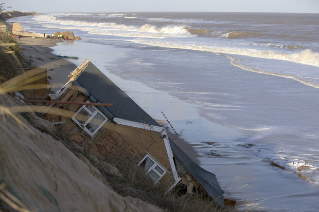 Homes collapsed into the sea during a tidal surge at Hemsby, in the east of England
