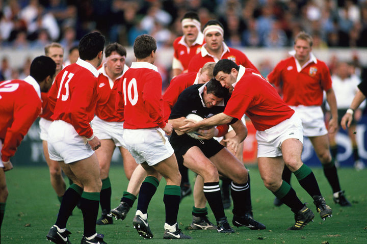 Sean Fitzpatrick tackled during the first All Blacks v Lions Test at Lancaster Park, Christchurch on 12 June 1993.