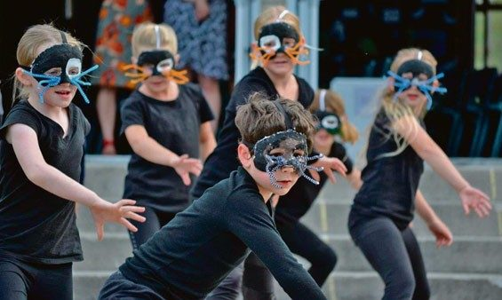 Children from Ohope Beach School performing the Evil Weasel Gang dance