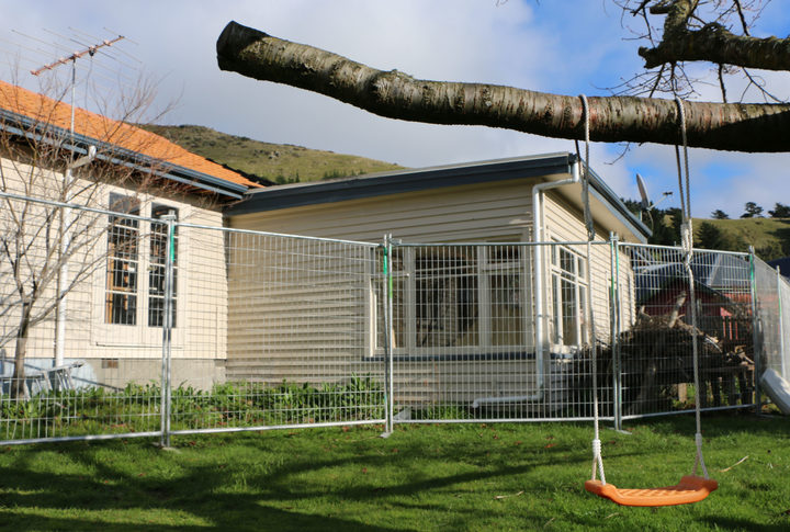 The family are living in a sleepout at the back of the property and are preparing a case against the EQC.