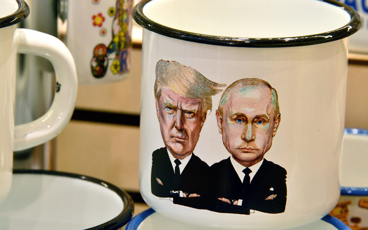 A souvenir shops offering among others cup a tin mug depicting Russian President Vladimir Putin and US President Donald Trump.