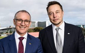 South Australian Premier Jay Weatherill  and Tesla Motors chief executive Elon Musk at the announcement, to build the world's largest battery, in Adelaide.