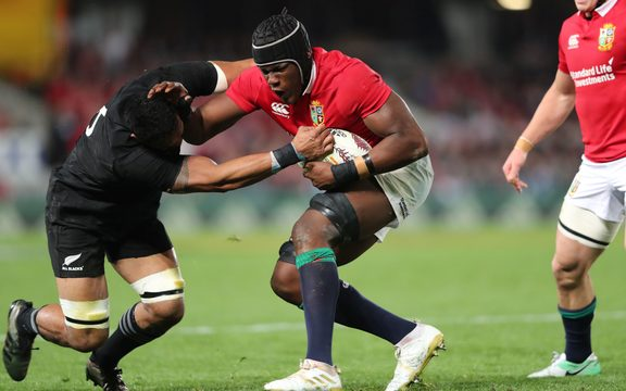 All Black Jerome Kaino is fended by Lions lock Maro Itoje.