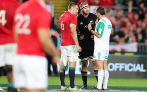 Referee Roman Porte talks to captains Sam Warburton and Kieran Read before changing his ruling from an ABs penalty to a scrum in the dying moments.