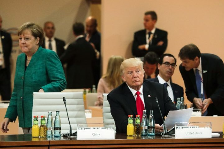 American president Donald Trump and German chancellor Angela Merkel attend G20 talks