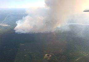 A wildfire seen burning near the town of 100 Mile House.