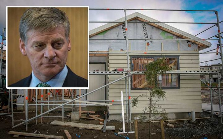 Prime Minister Bill English (insert) and a house under construction