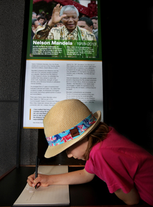 Aimee Chandler, 7, signs the remembrance book at Te Papa.