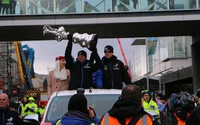 Team New Zealand hold the Auld Mug aloft in the Christchurch parade.