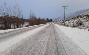 Grit trucks were hard at work on roads in the central Otago area today.