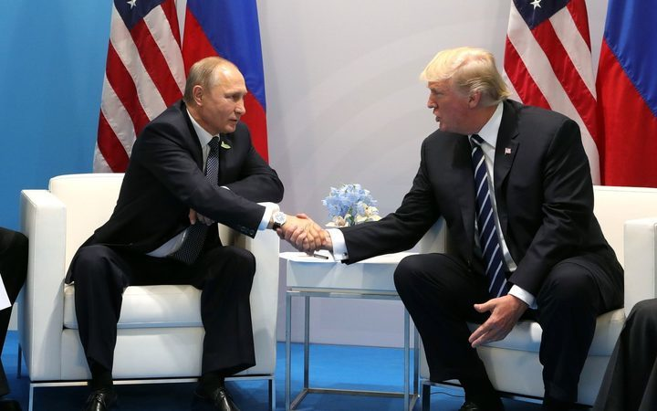 Russia's President Vladimir Putin and US President Donald Trump shake hands during a bilateral meeting on the sidelines of the G20 summit.