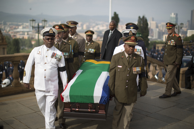 Military officers carry Nelson Mandela's coffin to the Union Buildings.