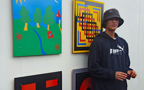 Nathan Cole with his art