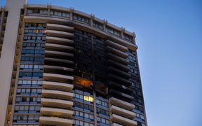 The charred exterior of the Marco Polo Building in Honolulu is pictured after a fire broke out on the upper floors