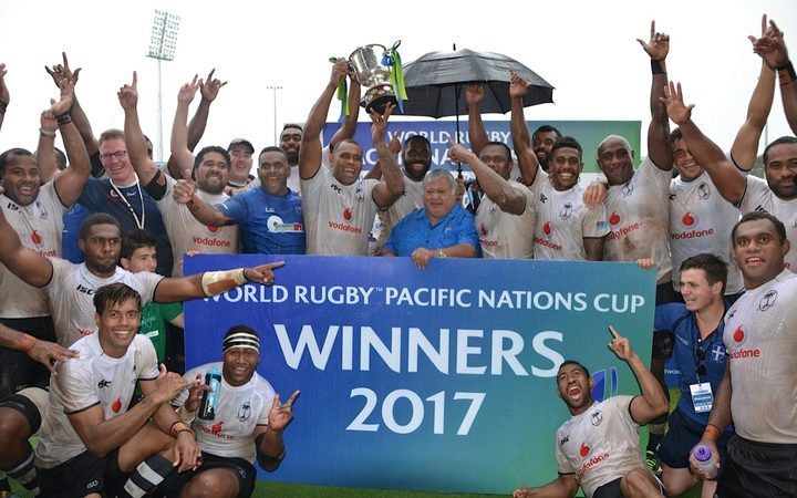 Fiji celebrate winning their third straight Pacific Nations Cup title.