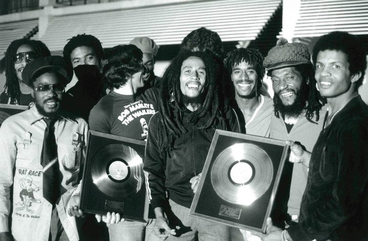 Bob Marley and the Wailers with their Gold Discs for NZ record sales