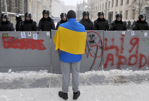 A protester confronts police guarding the office of President Viktor Yanukovych.