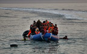 Refugees and migrants massed onto an inflatable boat reach Mytilene, northern island of Lesbos, after crossing the Aegean sea from Turkey last February.