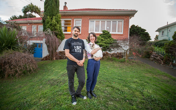 Stu Harwood and Jenna Todd outside their rented house in Mount Roskill, Auckland