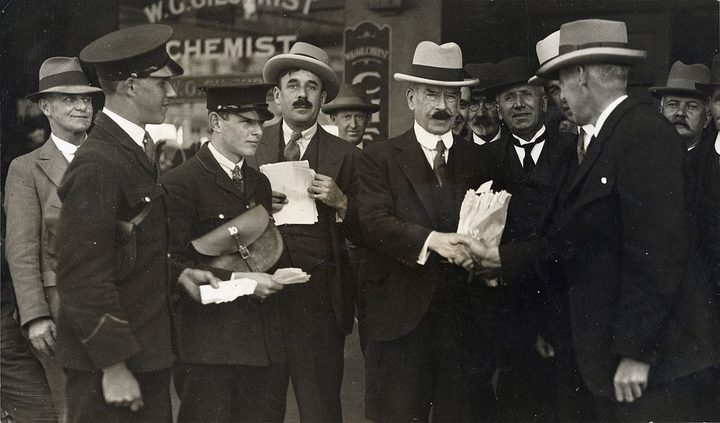 Joseph Ward receiving congratulations after 'accidentally' winning the 1928 election.