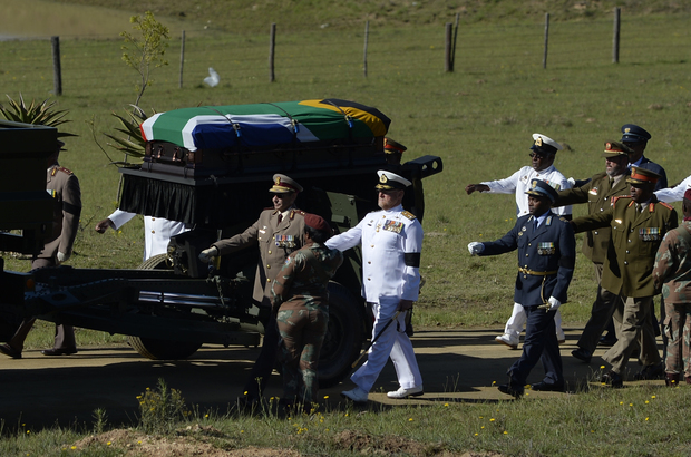 The coffin of Nelson Mandela is escorted as it arrives for the funeral ceremony.
