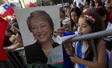 A supporter holds up a poster of new Chilean president Michelle Bachelet.