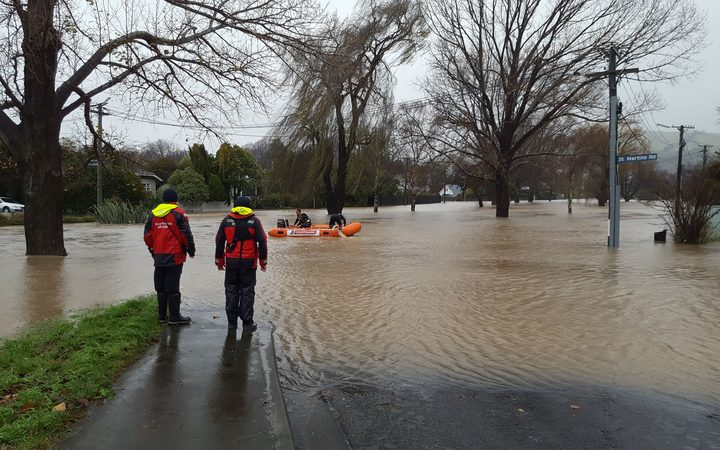Flooding around the Heathcote River in Christchurch has seen the Coastguard called in to help reach stranded residents.