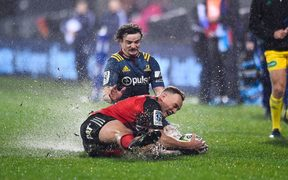 Israel Dagg of the Crusaders is tackled by Richard Buckman of the Highlanders.