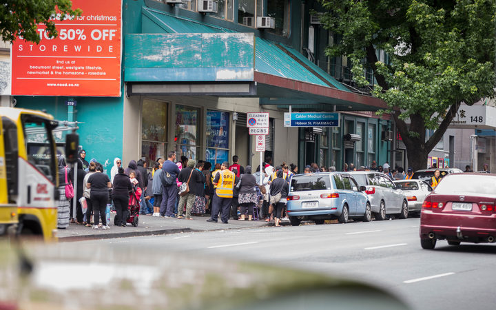 People queue outside Auckland City Mission in the lead-up to Christmas, 2015. City Missioner Chris Farrelly says school holidays are a particular time of hardship,