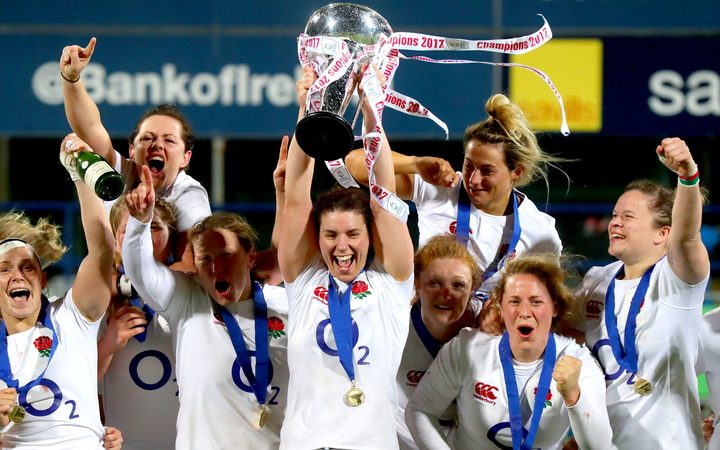 The England women's rugby team celebrates their Six Nations win earlier this year.