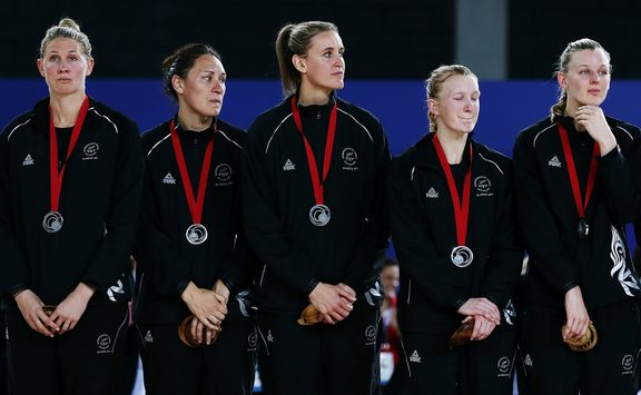 A disappointed Silver Ferns side with their silver medals at the Glasgow Commonwealth Games