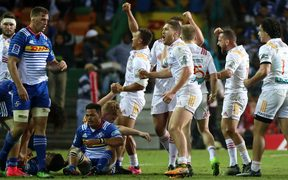Tawera Kerr-Barlow and the Chiefs celebrate their win over the Stormers in Capetown.