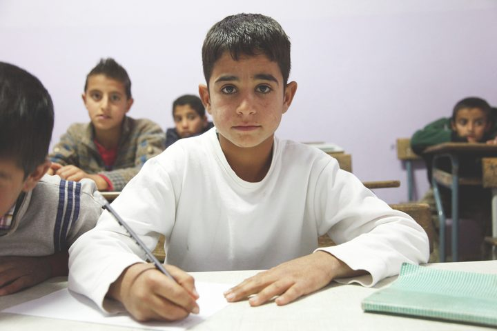 An 11-year old refugee from Syria at school in Lebanon
