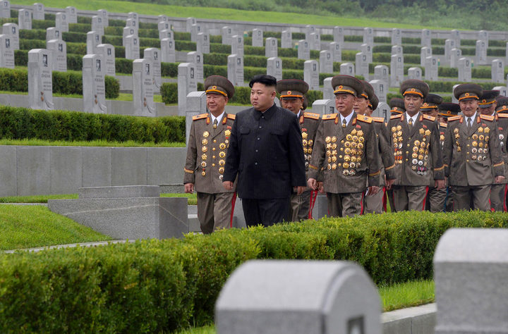 North Korean leader Kim Jong-Un (C) visiting the Fatherland Liberation War Martyrs Cemetery in Pyongyang.
