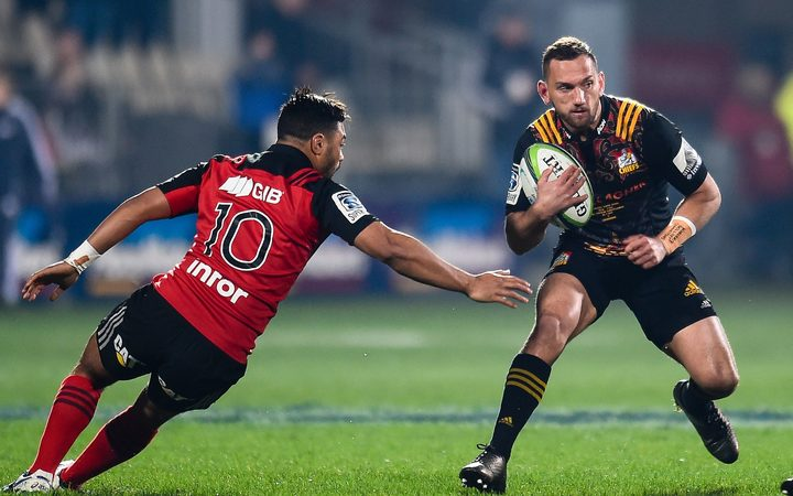 Aaron Cruden of the Chiefs eludes Richie Mo'unga during the first Super Rugby final.