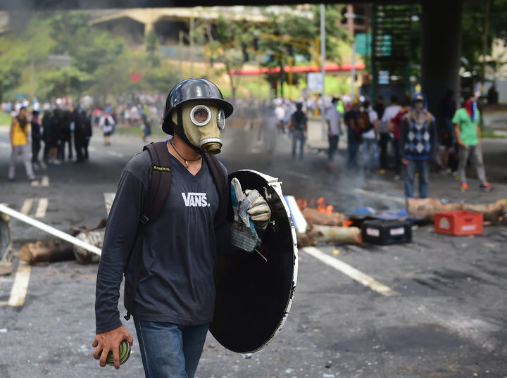Protesters set up barricades in Caracas.