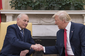 Donald Trump shakes hands with newly sworn-in White House chief of staff, retired General John Kelly.