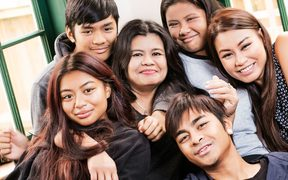 Mabel Pe with her five children, Marian (17), Samuel (14), Richelle (12), Daniel (21), Michelle (25).