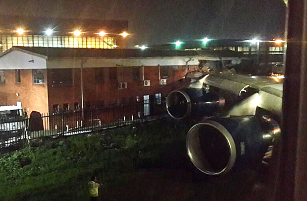 The wing of the British Airways plane hit an office building.