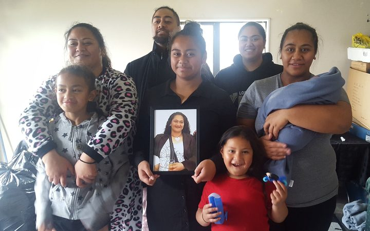 Miria Esera left, with her family.