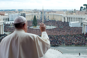 Pope Francis gives his blessing from a balcony at the Vatican.