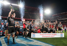 Crusader Sam Whitelock celebrates winning the 2017 Super Rugby trophy at Ellis Park Stadium.
