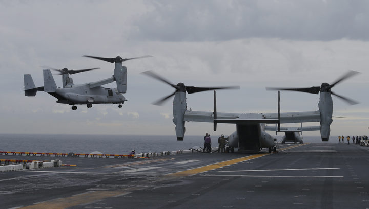 Osprey aircraft take off from the deck of amphibious assault ship the USS Bonhomme Richard during the Talisman Sabre exercise