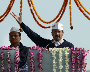 Chief Minister Arvind Kejriwal gestures as he addresses supporters after taking the oath of office in Delhi.