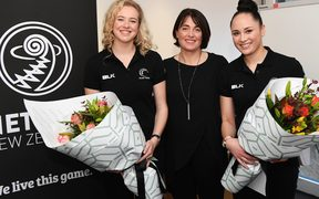 Monica Falkner (L) and Whitney Souness are presented with flowers by coach Janine Southby.