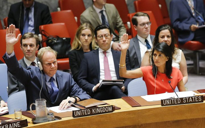 US Ambassador to the United Nations Nikki Haley (R) and Britain's Ambassador Matthew Rycroft vote on a US-drafted resolution toughening sanctions on North Korea, at the United Nations Headquarters in New York, on August 5, 2017.