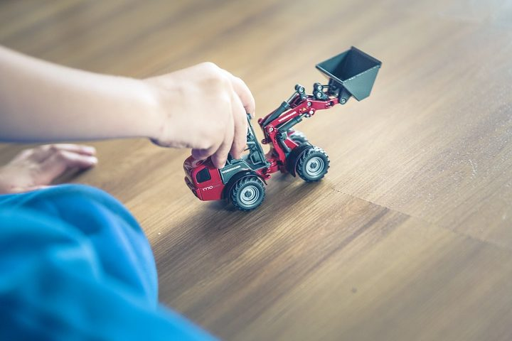 Child's hand with toy truck